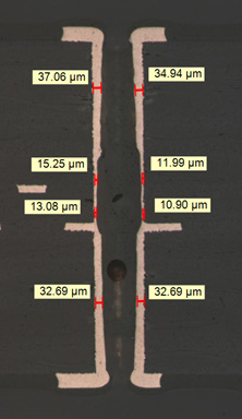<p>Plated Through-Hole (PTH) showing copper plating thickness in the center region is below the minimum requirement of 18um in <strong>IPC-6012B, Table 3-4.</strong></p>