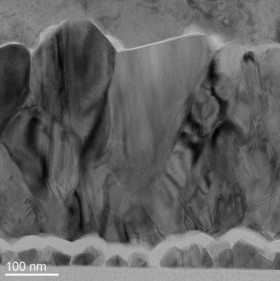 <p>TEM micrograph capturing the interface between two layers of distinct materials with various crystalline phases. This image was shot at 35kx magnification.</p>